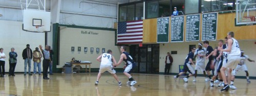 Aaron Trigg applies some solid defense to Dan Main of Wheelock