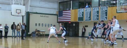 Aaron Trigg applies some solid defense to Dan Main of Wheelock