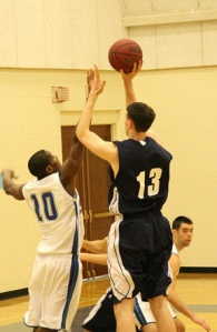 Greg Walker - Shooting over a Salve Regina defender on his way to 17 points and 10 rebounds.
