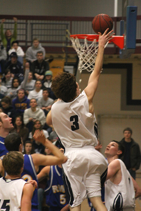 Ben Gaskill (6-9 junior) Plays above the rim on his way to 14 points vs Roger Williams - photo courtesy Ron Harden