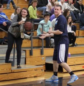 David Dempsey gives his 1000-point ball to his sister Megan