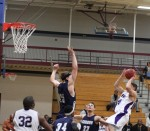 David Dempsey leaps to defend a shot