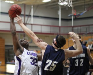AJ Stephens (32) and David Dempsey (25) in action under the basket