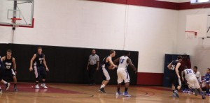 Jose Stable (12) drives right in the last ten seconds guarded by David Dempsey