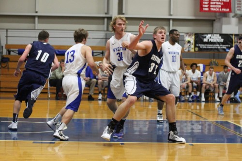 Hans Miersma, shown here against Wheaton, had 15 points, 15 rebounds, 7 blocks, and 3 assists against Wentworth.