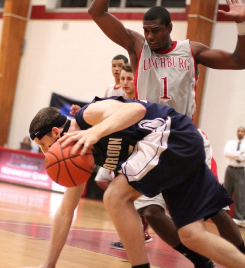 Michael Wims (22 points) defends a stumbling David Dempsey