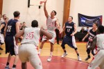 Manny Hernandez (24) puts up a floater in the lane