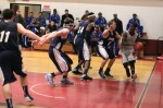 Xavier Parham (2) on the baseline guarded by Chris Alderson (1)