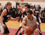 Brandan Connor (10 points and 6 steals) looks for an opening