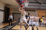 Cam Sennick gets a rebound in front of Jordan Kelly