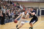 David Dempsey (18 points) drives on Matt Kneece