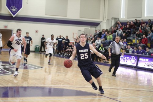 David Dempsey, preparing to dunk, scored twenty-two points to move into eighth place on the Gordon College all-time scoring list