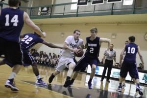 Justin Kuntz tries the lane with Taylor Bajema defending