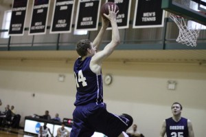 Jason Dempsey (12 points) flies toward the basket as his brother David watches