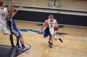 Taylor Bajema (shown here against Roger Williams) had 12 points, 8 rebounds, and assisted on the winning basket