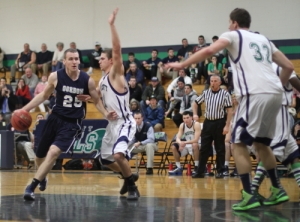 David Dempsey (18 points) drives on John Henault
