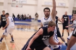 Hans Miersma (11 points) tries to drive on Conor Draleau