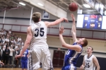Hans Miersma (CCC Defensive Player of the Year) blocks the shot of Mike Engemann