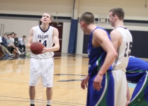 Jason Dempsey (9 points/9rebounds) smirks at the foul line