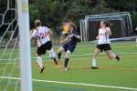 Olivia Balloveras (1 goal) looks to get control in the box