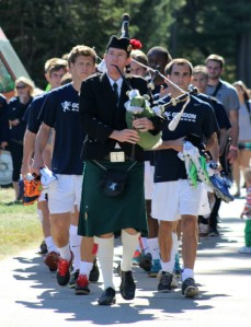 Bagpiper leads the Gordon team onto The Quad.