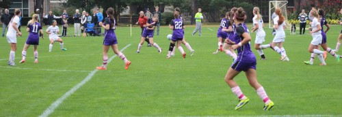 Shelby Palafox (#12) fires a shot through a crowd that deflected in.
