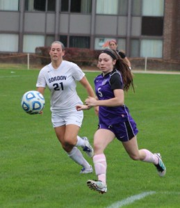 Jamie Breton (21) and Karyn Colomey (5) chase a loose ball