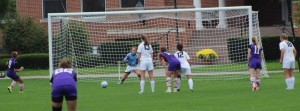 Kaitlyn Lima (9) sends a PK to the right corner