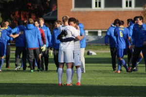 Seniors Andrew Vandervoort and Kellen Kasiguran console each other afterwards