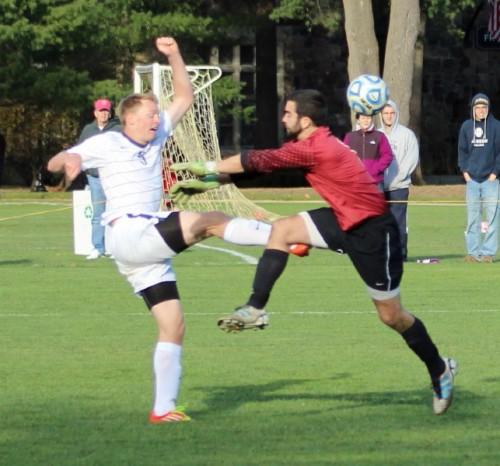Andrew volleys the ball past RW goalie Jon Pelloso