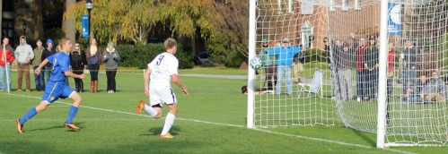 Andrew chases the ball into the net