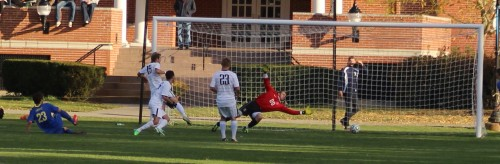 Jesse DiPietro (23) slides the game winner past four Gordon defenders