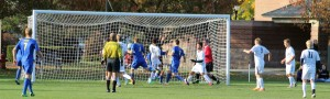 Andrew Carlson (11) about to drive the ball into an open net to quickly tie the score