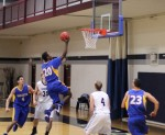 Freshman Marquez McKreith-Collins floats in the lane