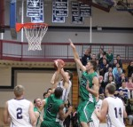 Andre Makris (22) goes for a block