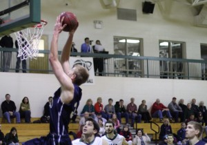 Hans Miersma (16 points/14 rebounds) moves in for a dunk