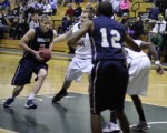 Taylor Bajema (14 points) gets into the lane