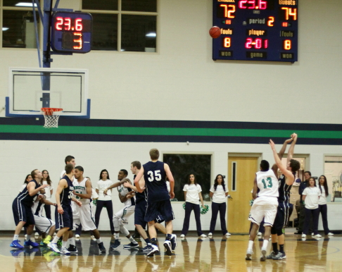 Luke Hamilton launches the three from the right that gave Gordon a five-point lead late in the game.