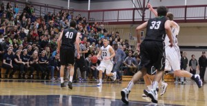 Park Thomas dribbles the ball in front of a good-sized Bennett Center crowd