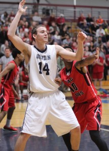 Jason Dempsey (13 points) looks for a pass
