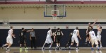 Taylor Bajema (#2) heads in for a key offensive rebound late in the game