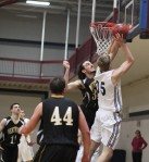 JohnMichael Fragnoli goes for the block against Hans Miersma