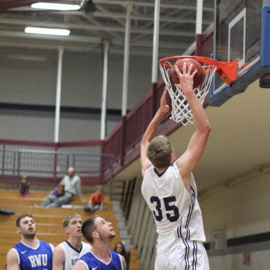 Hans Miersma moves in for second-half dunk vs Roger Williams