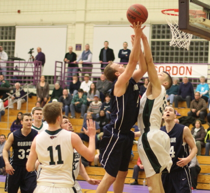 Alex Carnes (20 points) shoots from in close