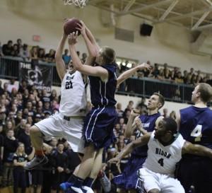 Sam Johnson goes for the block