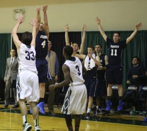 All eyes are on the 3-point attempt of Alex Carnes (#4)