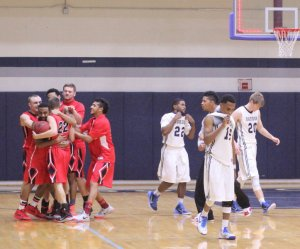 Justin Wagner (#22) mobbed by teammates