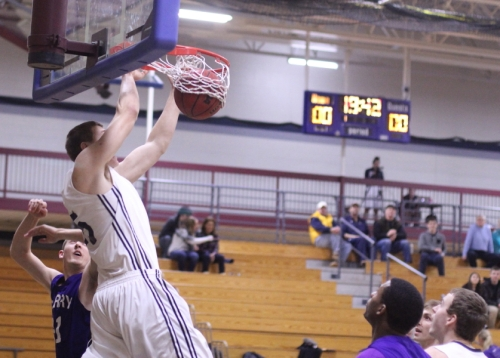 Hans Miersma (20 points) starts the Gordon scoring with a dunk