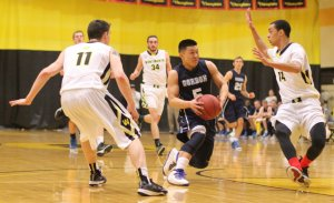 Jaren Yang (15 points) looks for an opening