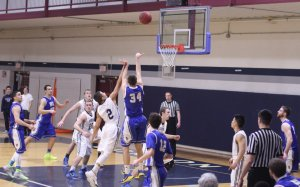 Alex Puzone (#34) puts up a shot